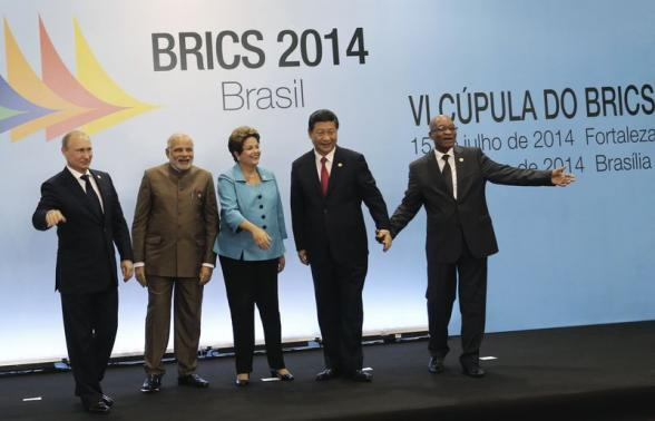 Russian President Putin, Indian Prime Minister Modi, Brazilian President Rousseff, Chinese President Xi and South African President Zuma smile at a group photo session during the 6th BRICS summit in Fortaleza