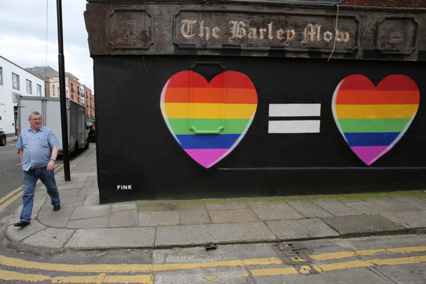 A man walks past a mural in favour of same-sex marriages in Dublin on May 21, 2015. Ireland goes to the polls tomorrow to vote on whether same-sex marriage should be legal, in a referendum that has exposed sharp divisions between communities in this traditionally Catholic nation.  AFP PHOTO / Paul Faith        (Photo credit should read PAUL FAITH/AFP/Getty Images)